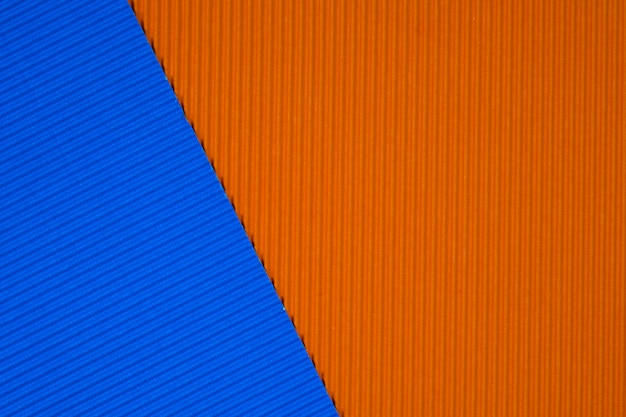 Blue and orange corrugated paper texture