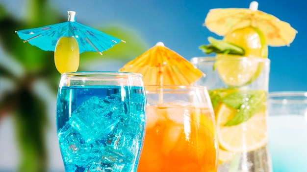 Blue orange drinks with sliced lime mint in glasses