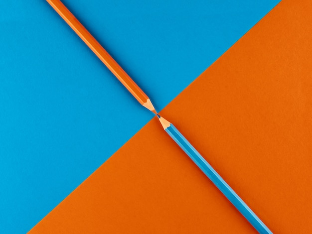 Blue and orange pencil on a contrasting background