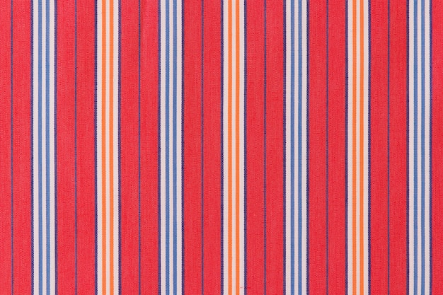 Blue and orange stripes on red background
