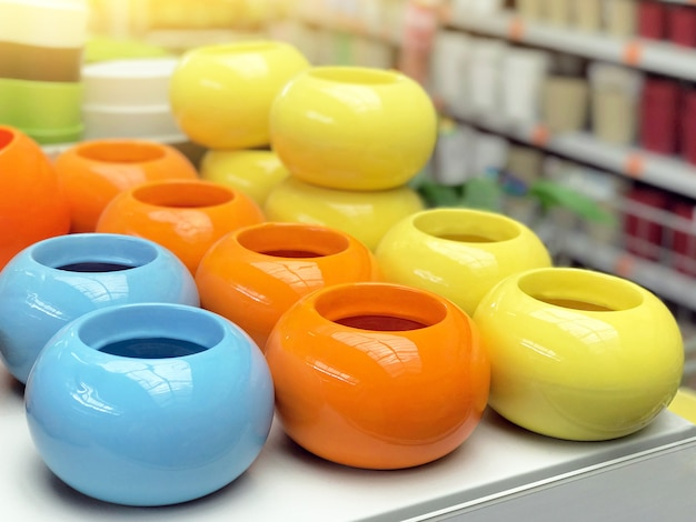 Blue orange yellow flower pots, store shelf