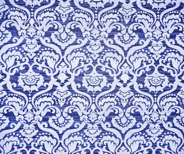Blue ornate vintage wallpaper. background or texture