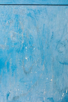 Blue paint on aged wooden surface