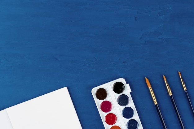 Blue paint brushes, view from above