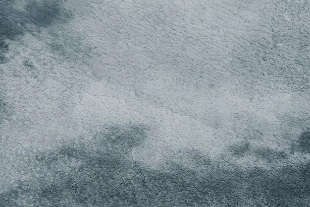 Blue paint grunge textured concrete background
