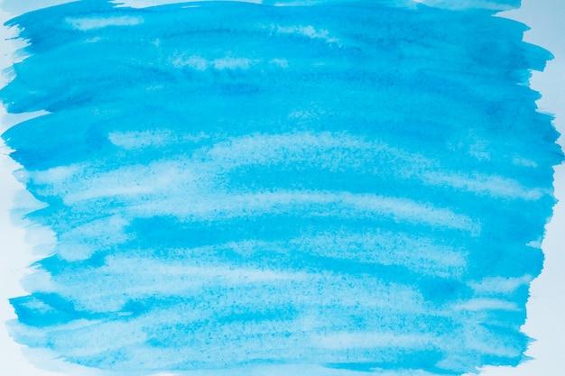 キャンバスに青いペンキの汚れ。しみのイラスト。用紙の背景。