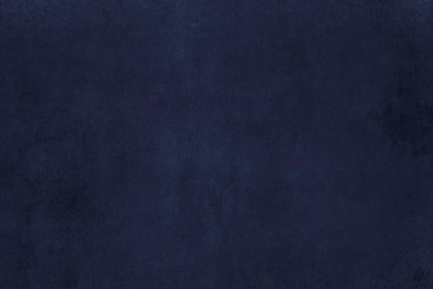 青い塗られたコンクリートの壁の織り目加工の背景
