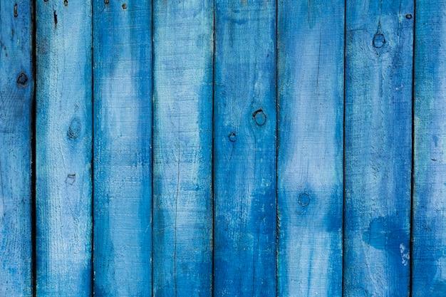 青い塗られた古い木製のテクスチャ