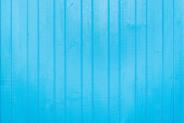 Синий окрашенный, обшитый доской деревянный текстурированный фон доски