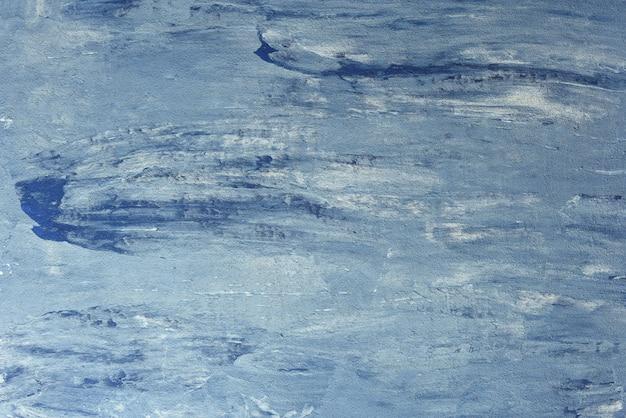 Голубой окрашены текстурированный фон. синий с белым почесал фон.