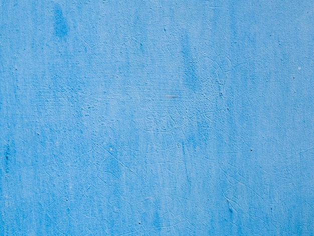 Blue painted textured wall background