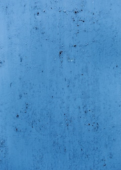 Blue painted wall texture with cracks
