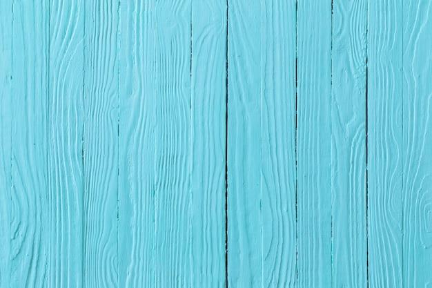 青い塗られた木製の背景