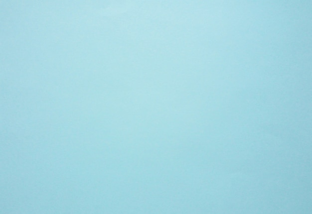 パステルカラーの青い紙。抽象的な青い背景。