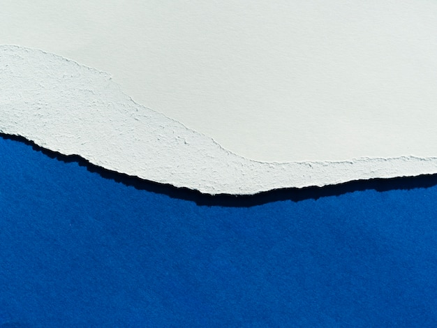 Blue paper layers with torn edge