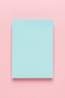 Blue paper on pink