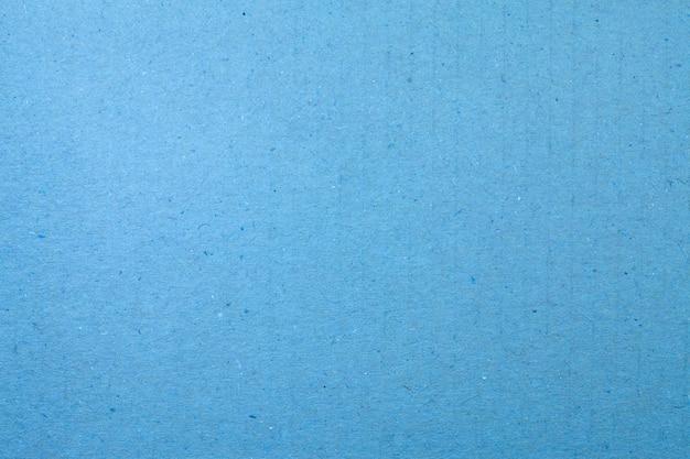 青い紙の縞模様のテクスチャの背景。