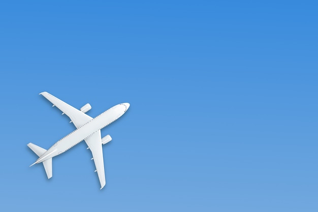Blue pastel paper airplane on blue Premium Photo
