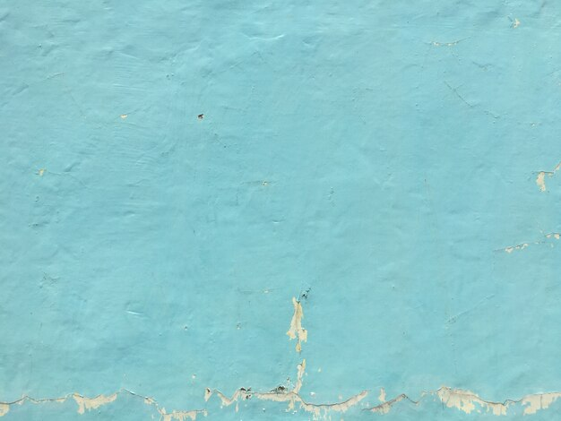 Blue peeling wall textured background