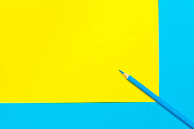 Blue pencil on color block top view