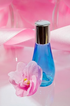 Blue perfume bottle with reflection