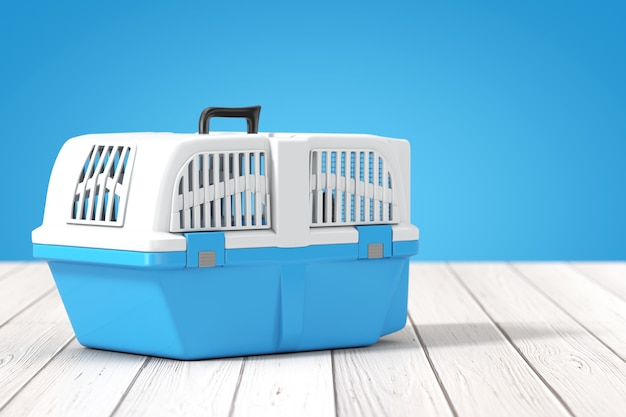 Blue pet travel plastic cage carrier box on a wooden table and blue background. 3d rendering