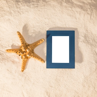 Blue photo frame and big starfish