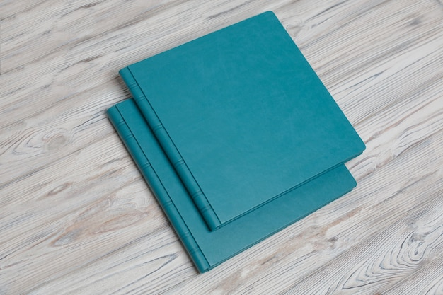 Blue photobooks on a wooden table