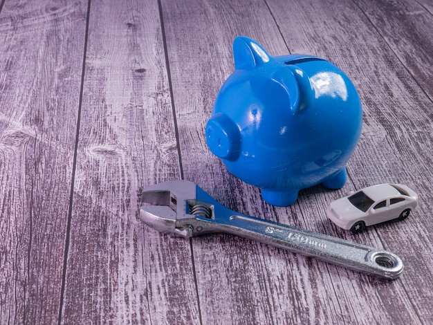 The blue piggy bank and car for saving or car concept