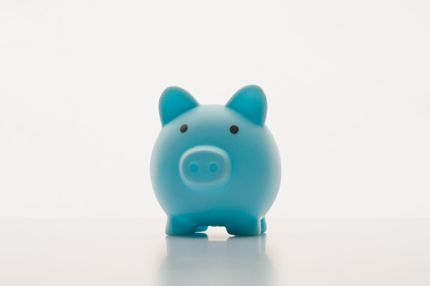 Blue piggy bank isolated on white.