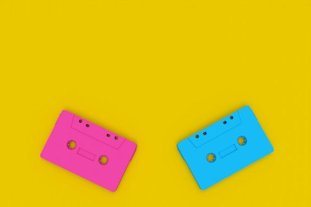 黄色の背景に青ピンクのカセットテープ
