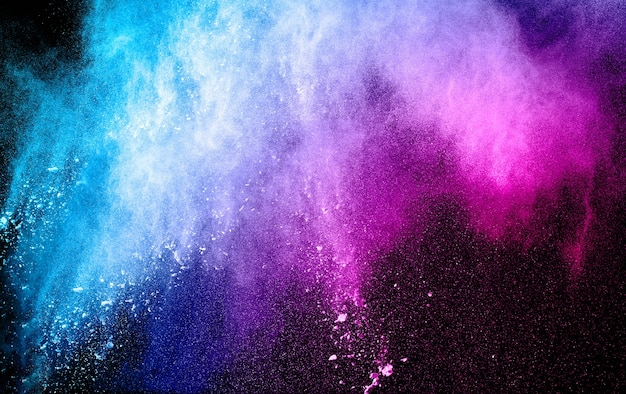 Blue pink powder explosion on black background.