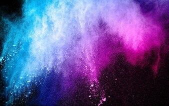 Blue Pink powder explosion on black background.
