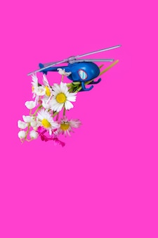 Blue pink purple paper box gift toy delivery helicopter flower background
