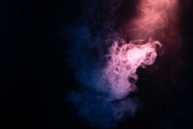 Blue and pink steam on a black background. copy space.