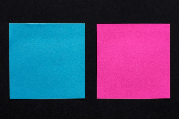 Blue and pink stickers on black background