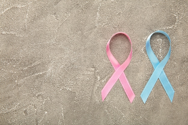 Blue and pink symbolic ribbon - the problem of cancer, breast cancer, prostate cancer ribbon. top view