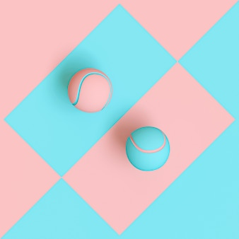 Blue and pink tennis balls on a two tone geometric background, flat lay style