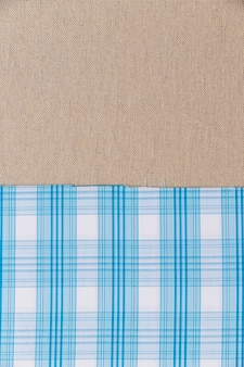 Blue plaid pattern textile on plain sack cloth