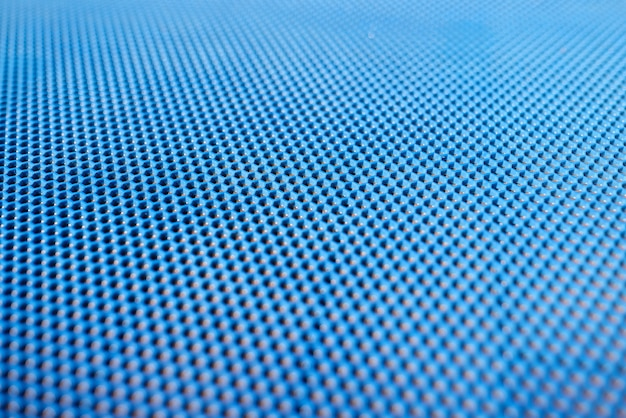 Blue plastic background with holes.