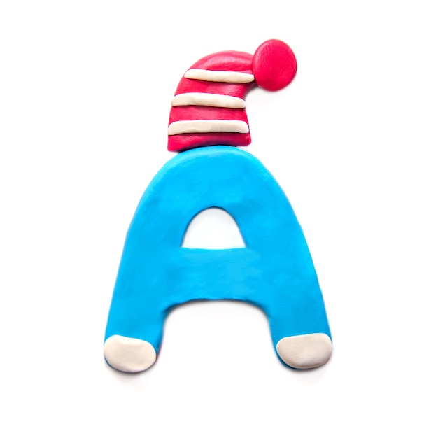 Blue plasticine letter a of alphabet in winter red hat on white background