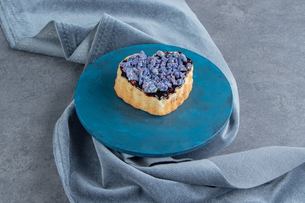 A blue plate with sweet heart shaped pastry