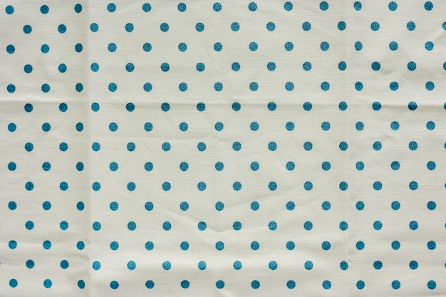 Blue polka dot fabric or tablecloth for background
