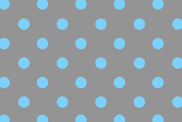 カラフルな背景と青い水玉
