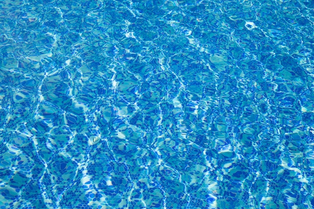 Blue pool water with sun reflections