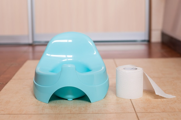 Blue potty with toilet paper