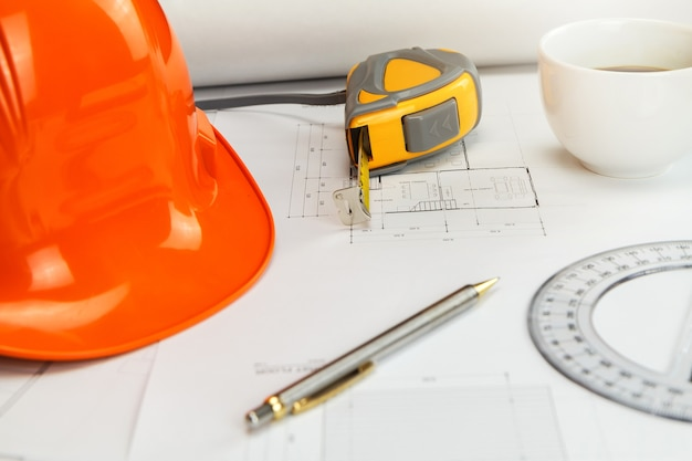 Blue print and measurement tool on architect's desk