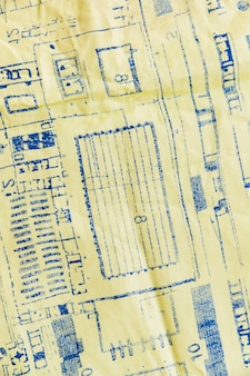 Blue print on yellow textile