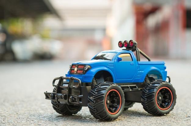 Blue rc toy suv truck car on the asphalt ground