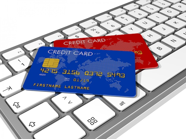 Blue and red credit cards on a computer keyboard